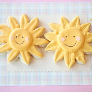 Sun Shine cookies frosted in golden yellow with smiley face